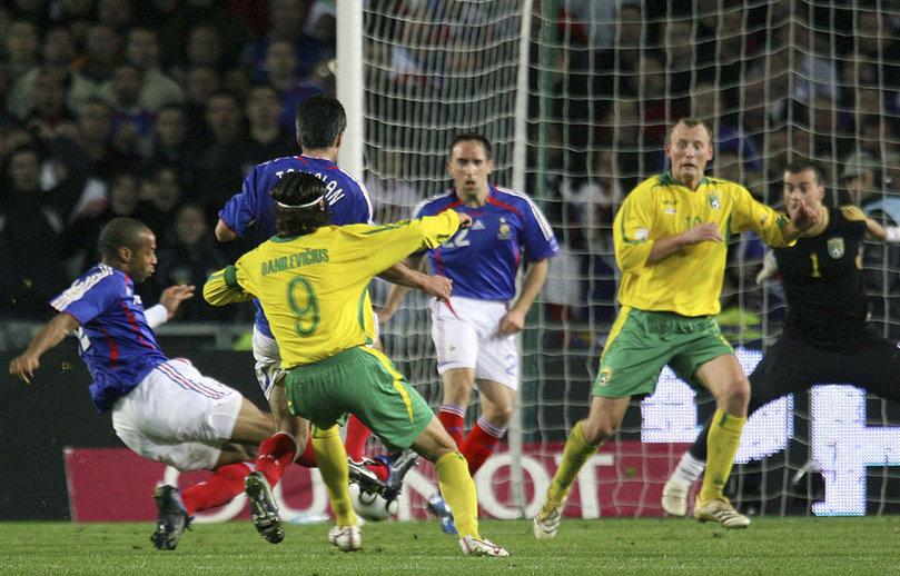 France's Thierry Henry scores against Lithuania during their Euro 2008 Group B qualifying soccer match in Nantes