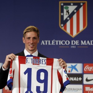 Spain forward Torres poses with his new jersey during his presentation ceremony at Vicente Calderon stadium in Madrid